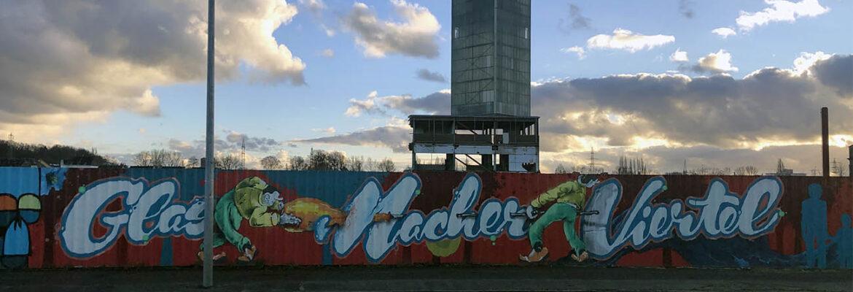Graffiti auf einem Bauzaun